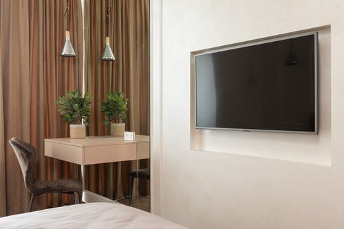 Apartment interior with TV near table with chair