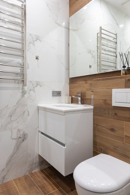 Interior of modern light bathroom with toilet
