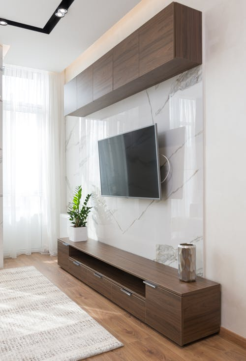 Interior of modern living room with TV on wall