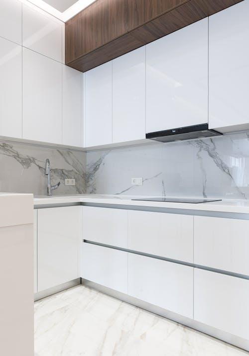 White furniture in light modern kitchen