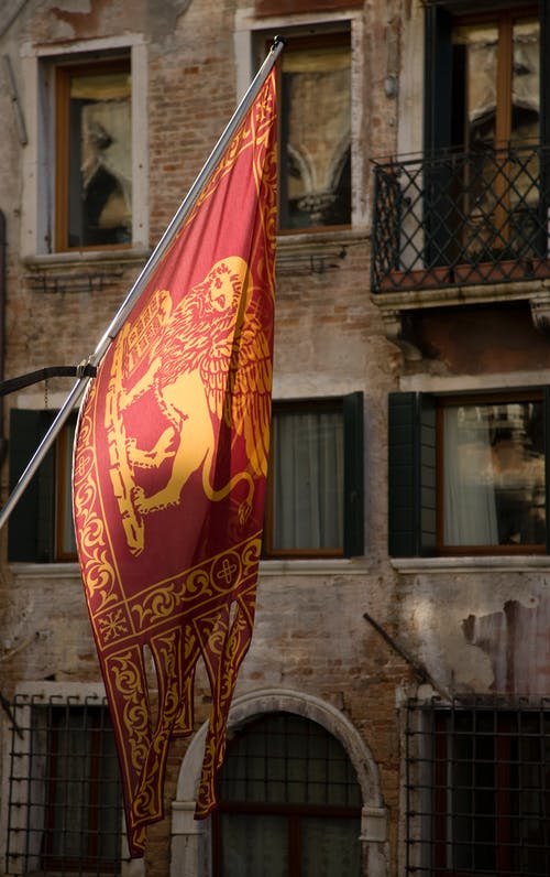 Red Flag Of Venice Showing A Winged Lion