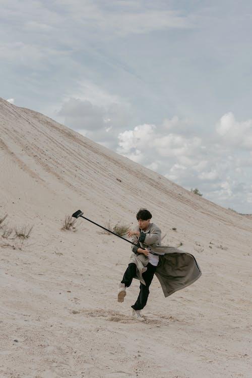 Foto profissional grátis de absurdo, areia, arenoso