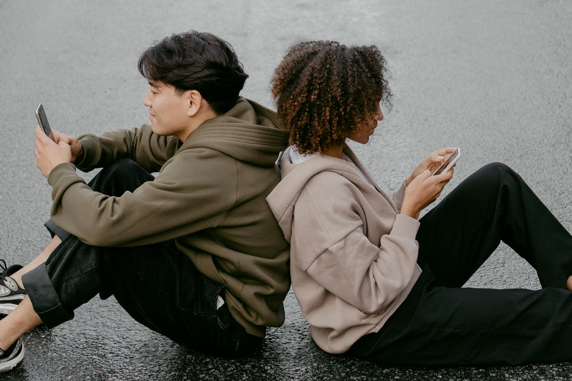 People Sitting On The Ground