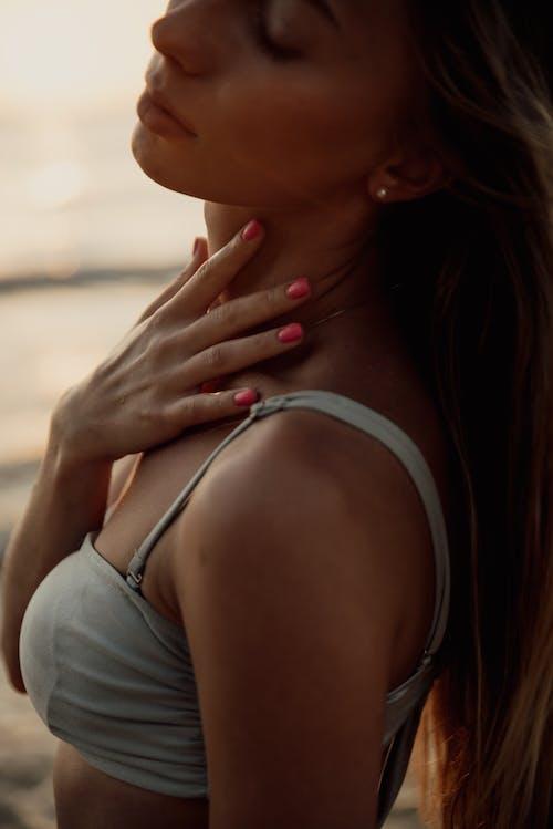 Woman In Gray Bikini Top Touching Her Body