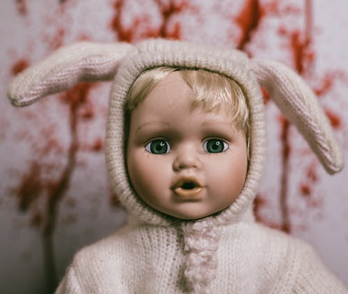 Baby Doll in White Knitted Sweater With Bunny Ears