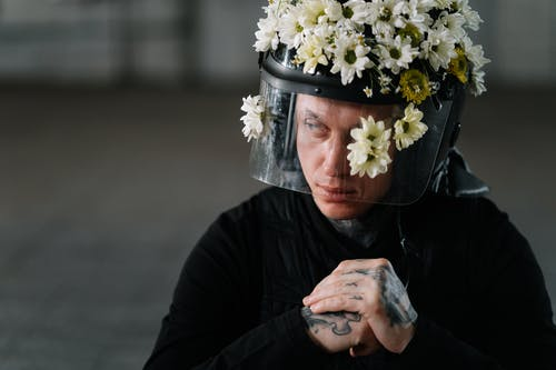 Man Wearing A Flower Covered Helmet