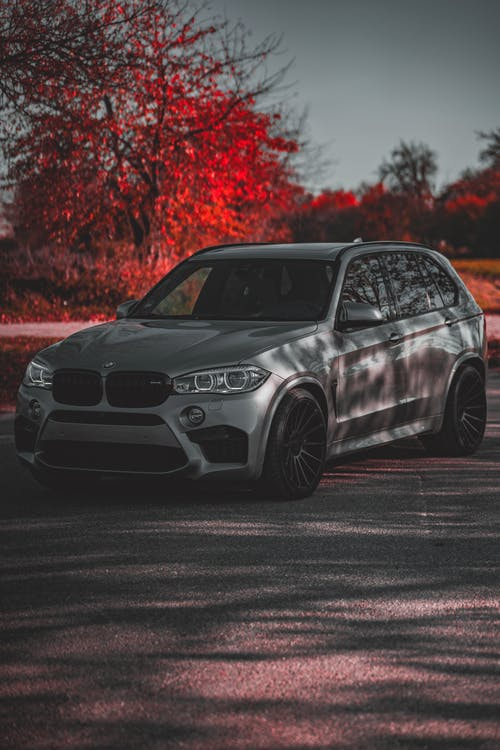 Silver BMW on Asphalt Road