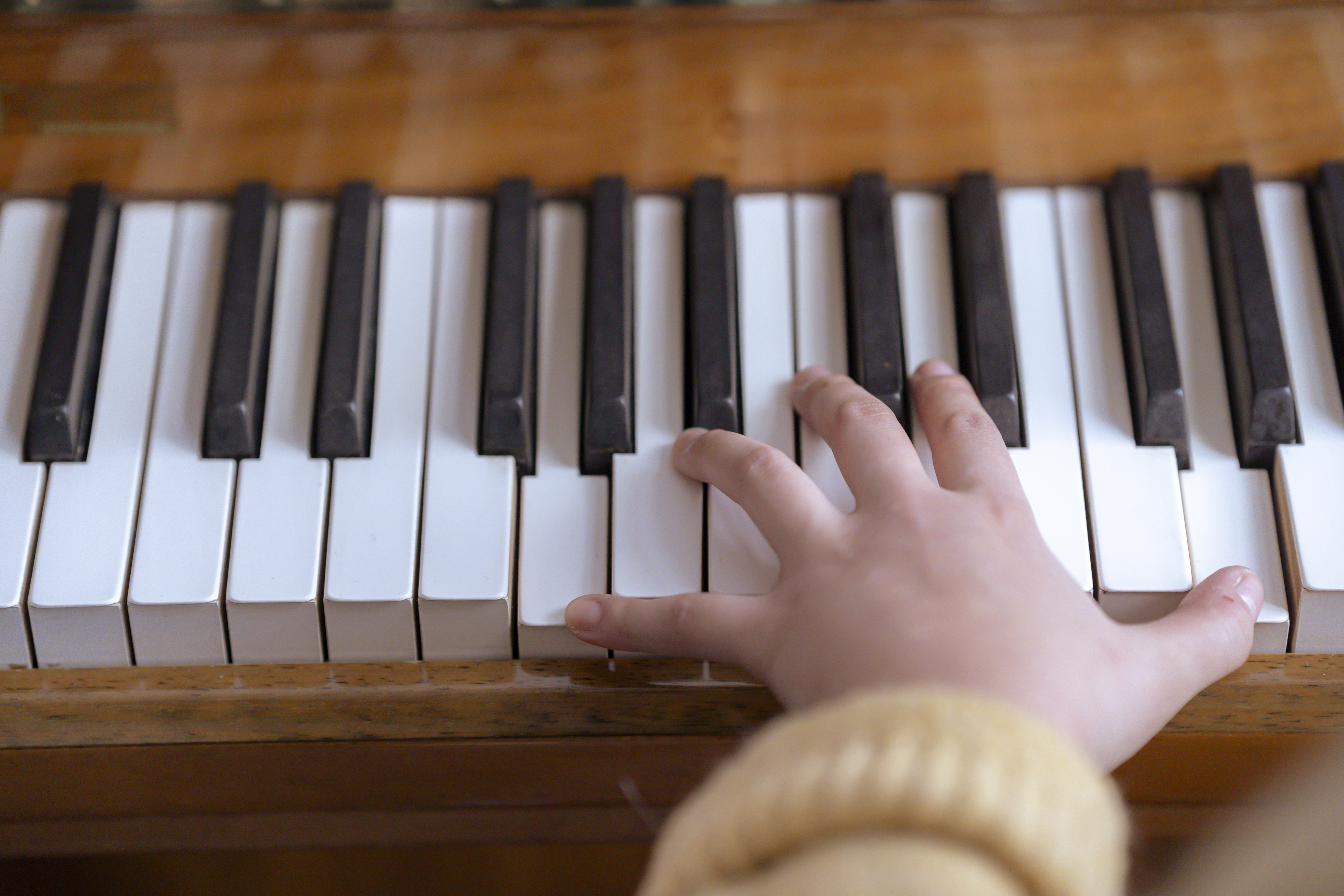Woman playing piano during rehearsal in music hall