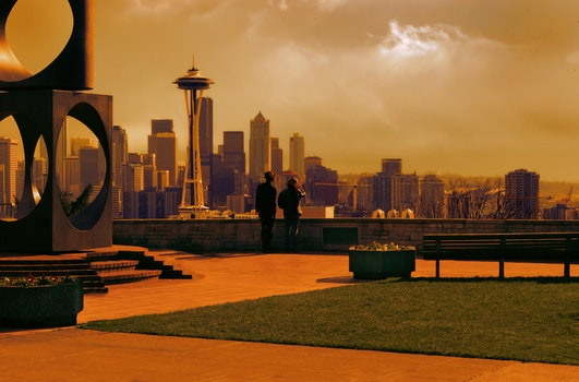 Man and Woman Looking at Space Needle Photo