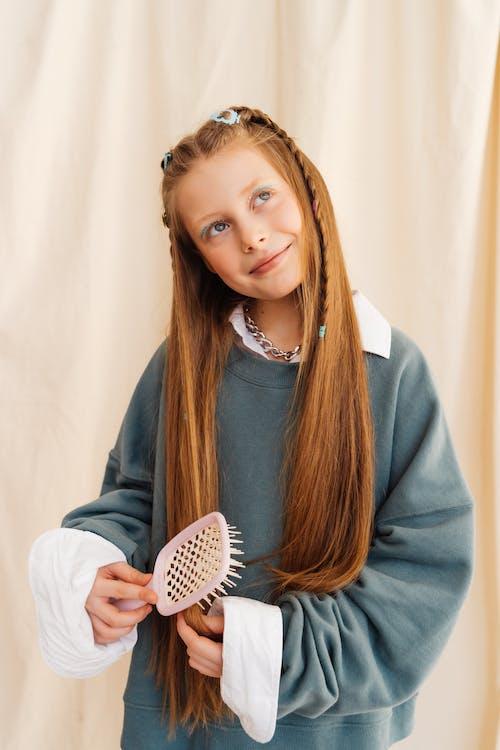Girl Brushing Her Hair