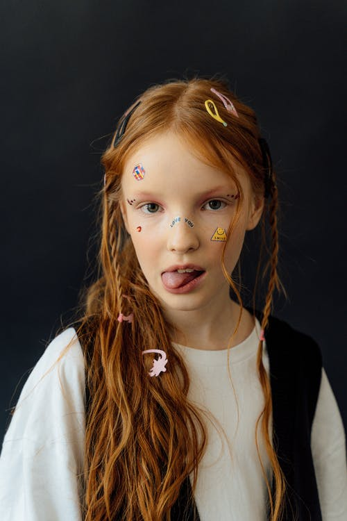 Girl with Stickers on Her Face