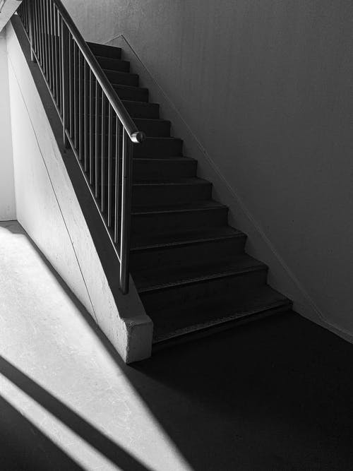 Black and White Staircase With White Concrete Staircase