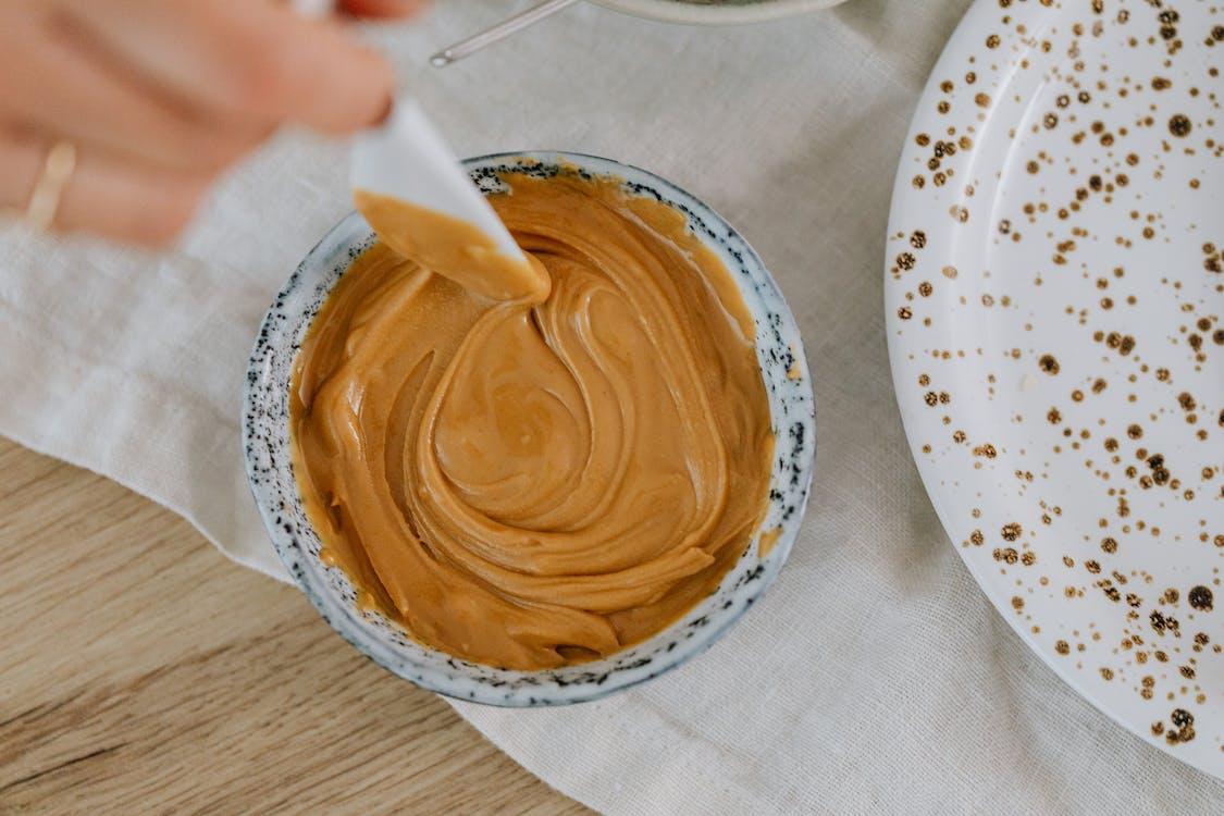 Brown Liquid in White Ceramic Bowl
