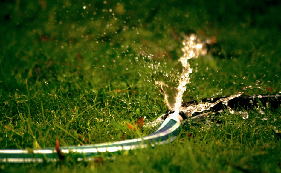 Close-Up Photography of Water Bursting Out of Hose