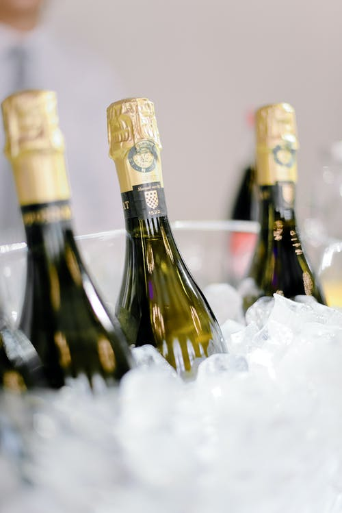 Bottles of champagne in ice cubes