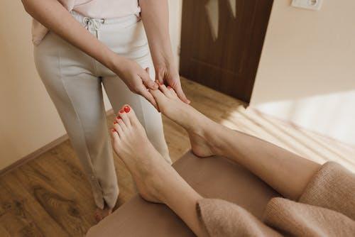 A Woman Having a Foot Massage