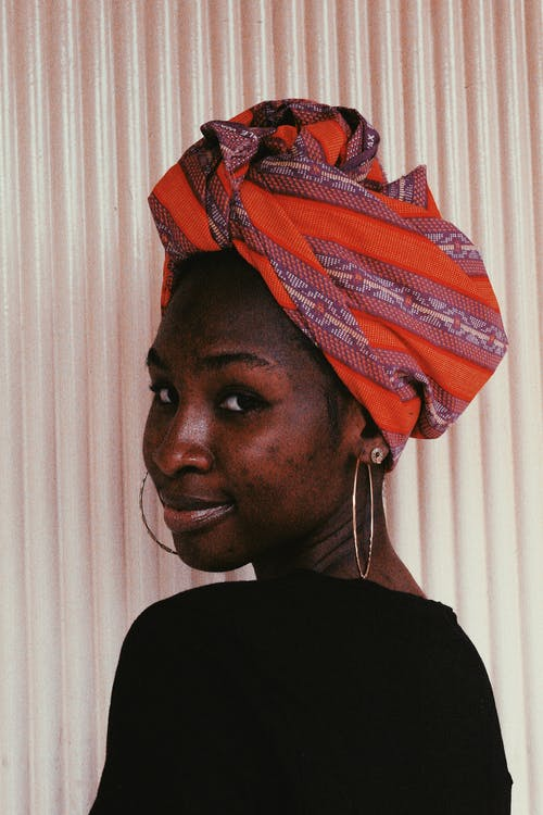 Pleasant African female with headscarf
