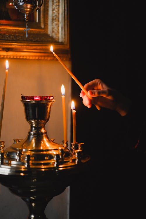 A Person Holding a Lighted Candle