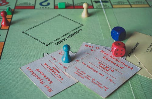 Close Up Photo of Monopoly Game Items