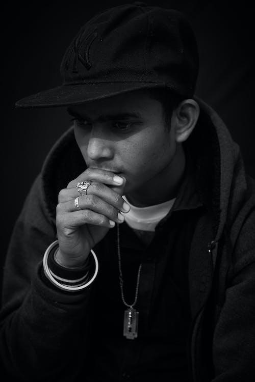 Man in Black Hat Smoking Cigarette