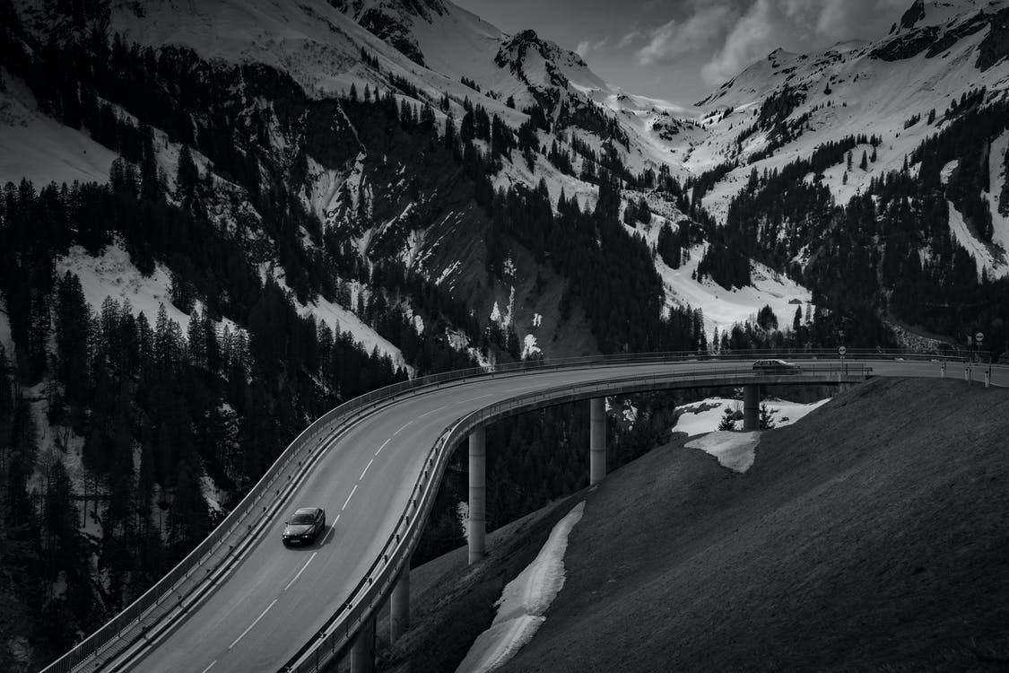 Grey Car on Road Near Snow Covered Mountain