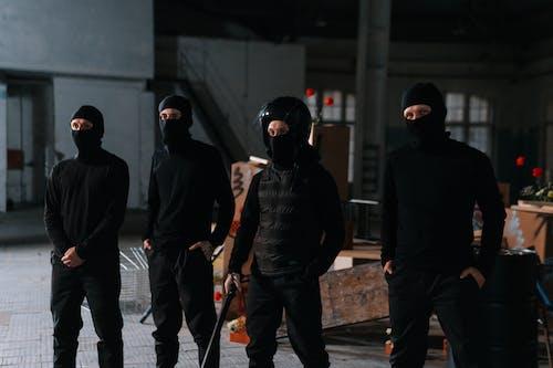 Men In Black Clothes Wearing Masks