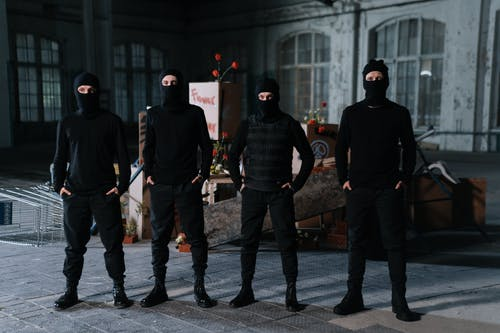 People In Black Clothing