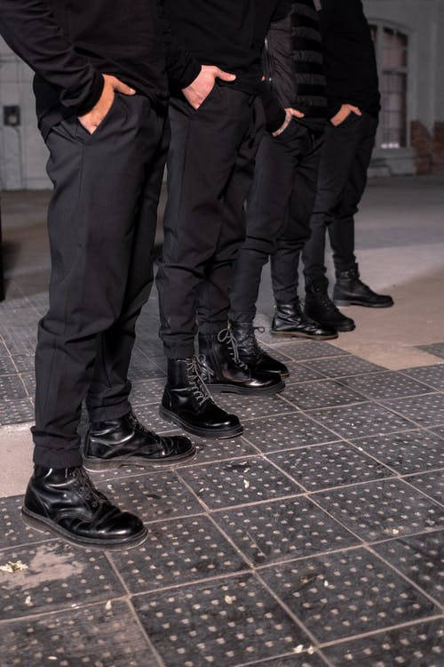 People Wearing Black Pants and Black Shoes