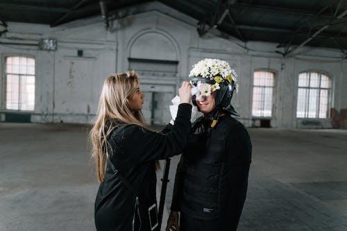 Woman Putting Flowers On A Helmet