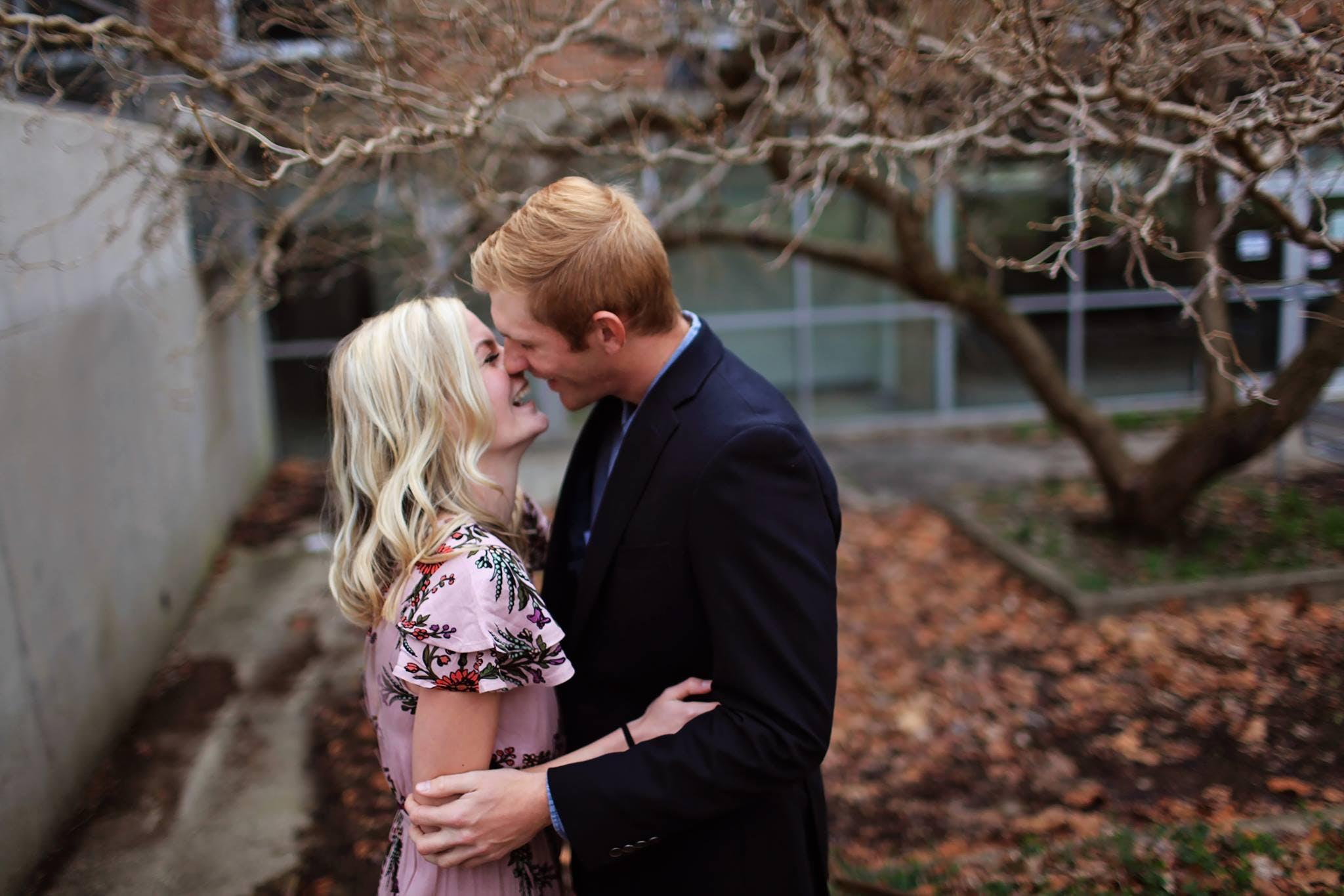 Smiling Couple Standing Near Bare Tree Outdoors Macro Shot