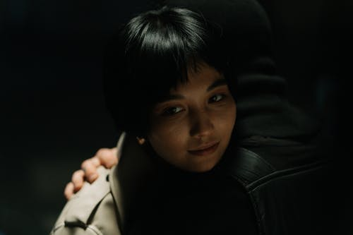 Photo Of A Woman Being Hugged