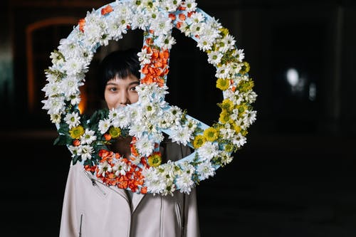 Woman Behind A Peace Sign