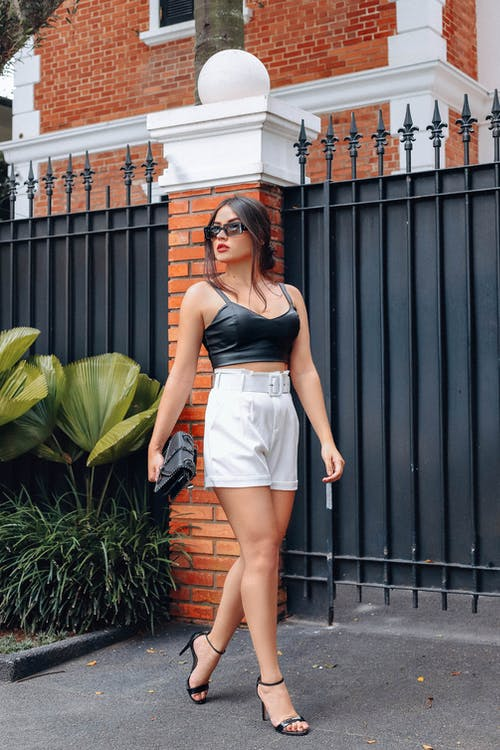 Woman in Black Midrib Top and White Shorts