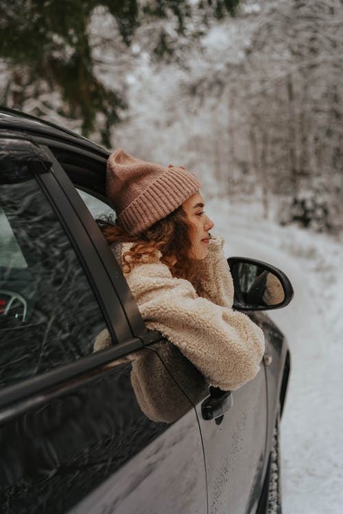 Person with Beanie in a Car