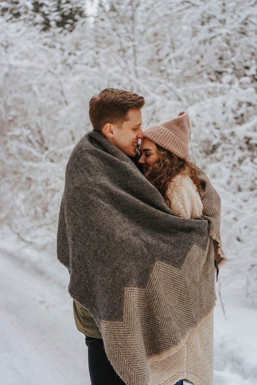 Couple Cuddling with a Blanket