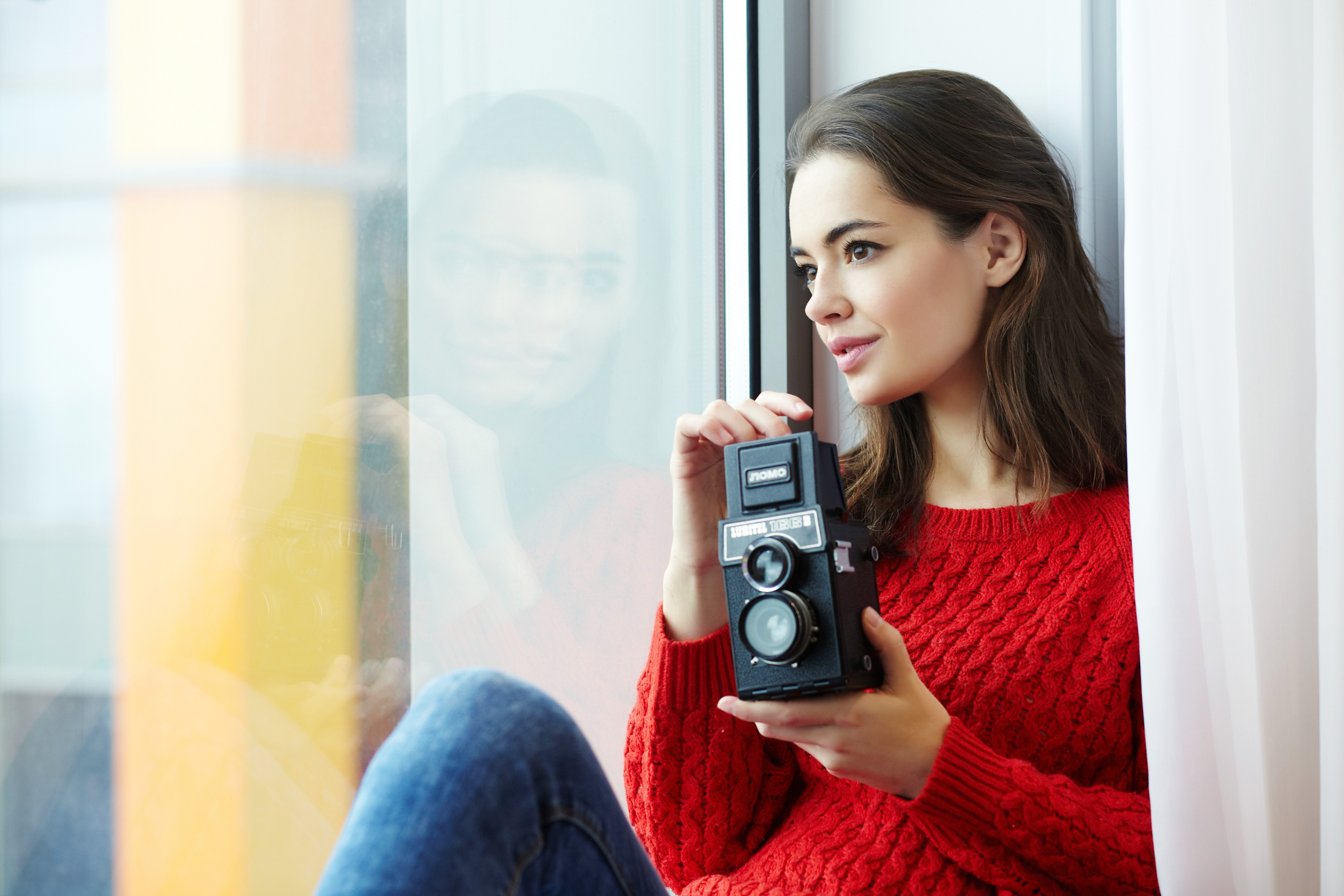 Woman Wearing Red Knitted Shirt Holding Instant Camera