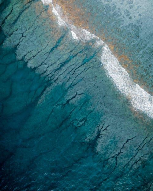 Deep blue water of ocean during tide