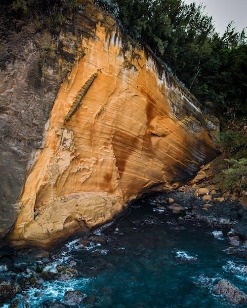 Rough rocky formation on seashore
