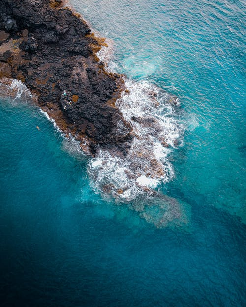 Rocky coast washed by azure sea