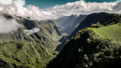 Grassy valley in mountainous terrain