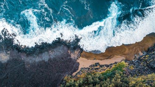 Waving sea washing sandy coast
