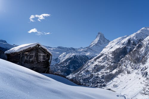 Old wooden house in snowy mountains