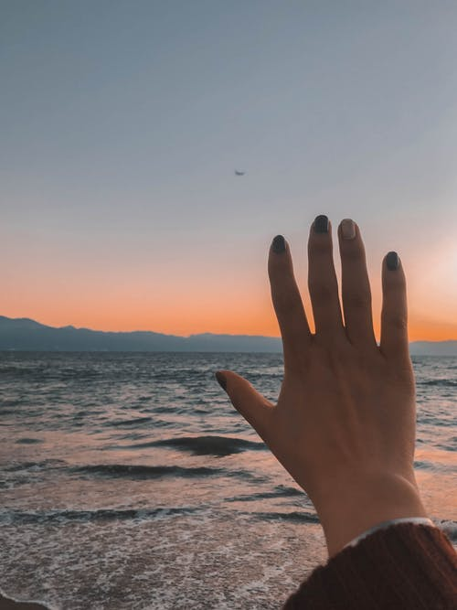 Free stock photo of hand, nails, sea