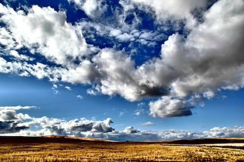 Kostenloses Stock Foto zu außerorts, bewölkt, blau, draußen