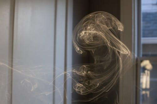 Cigarette smoke in motion in room