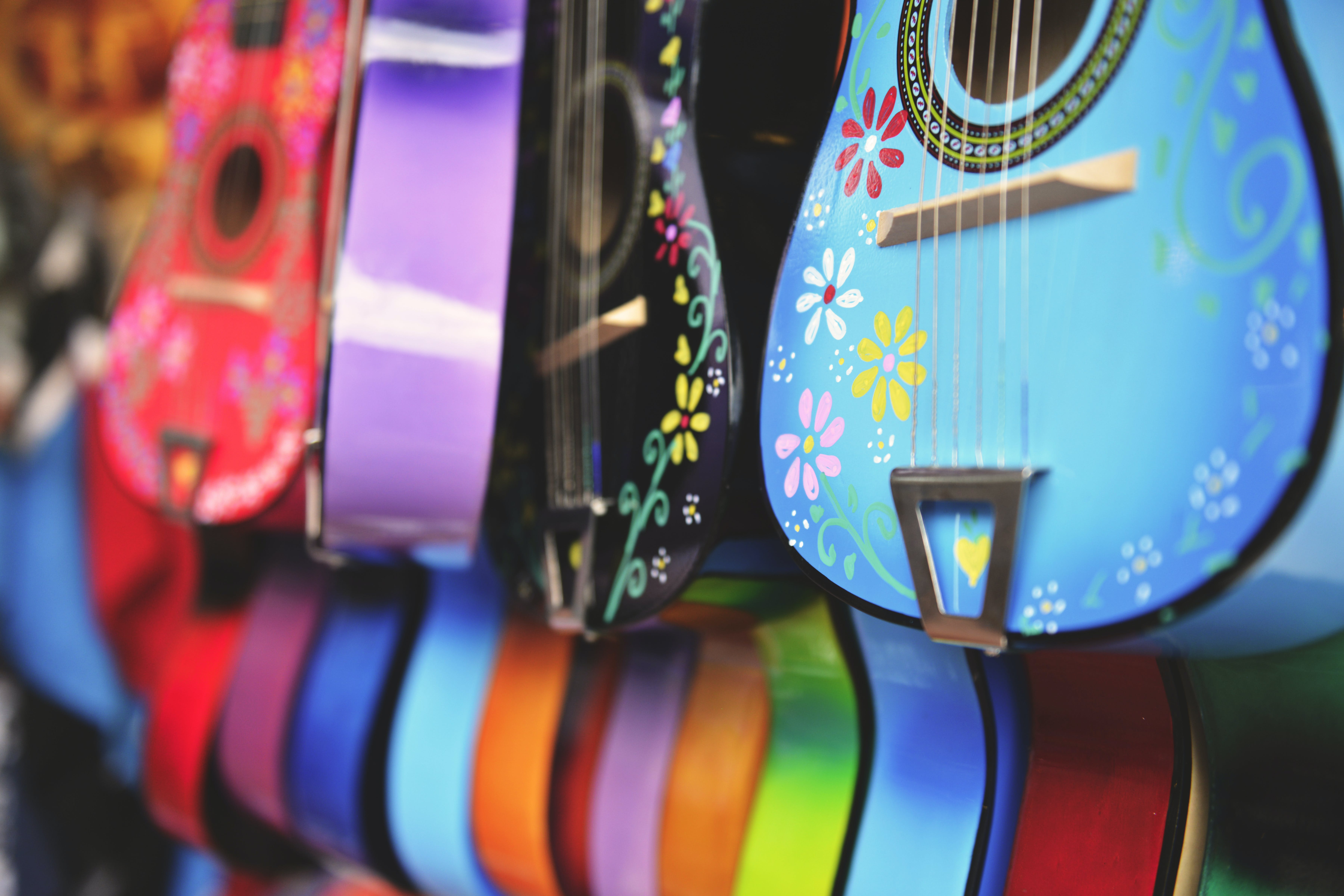 Blue, Purple and Green Acoustic Guitars