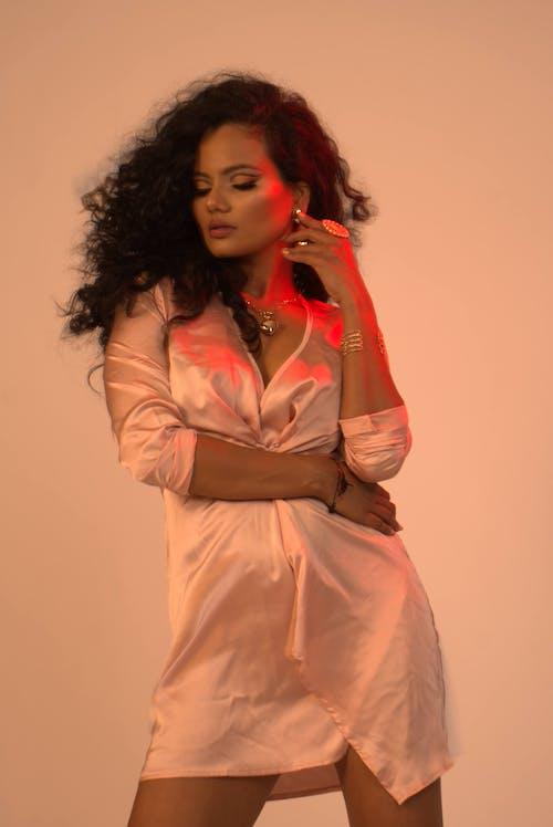 Serene black woman in silk bathrobe
