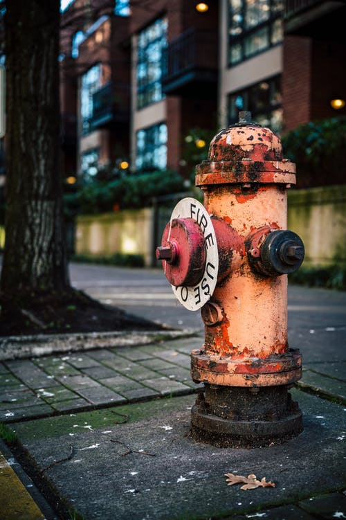 Rusty weathered fire hydrant on city street