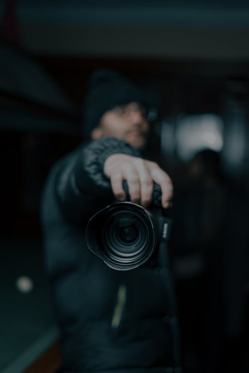 Photographer in outerwear with photo camera