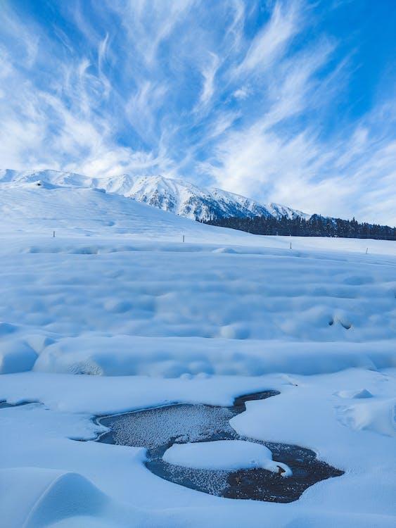 Frozen river near mountainous area